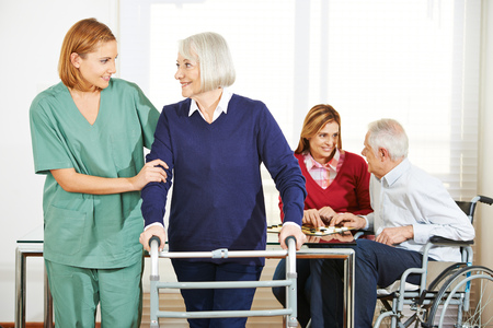 Home nursing care for senior couple at home photo