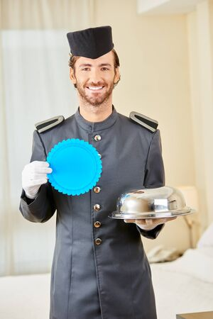 Room service in hotel with a blue award badge