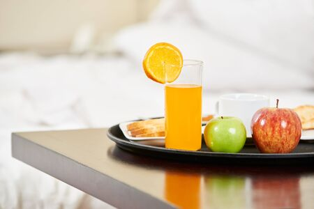 Healthy breakfast with orange juice and fruit on a tablet