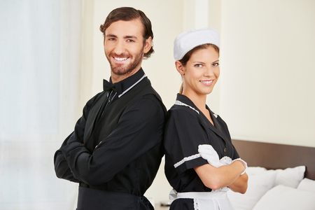 Maid and hotel concergie as team in a hotel room Stock Photo