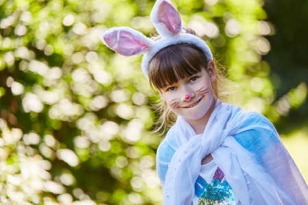 Girl with bunny constume and face paint Stock Photo