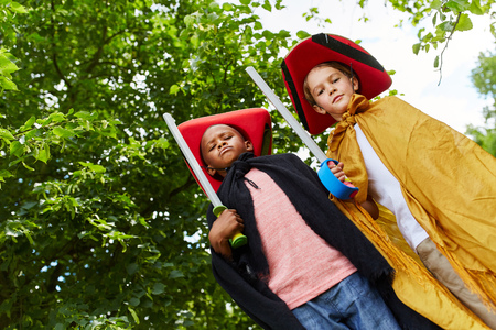 Two kids dressed like pirates play with their carnival costumes
