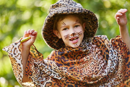 Boy having fun in childrens theater dressed up like leopard Stock Photo