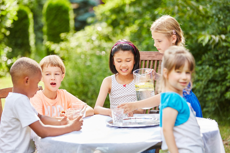 birthday party kids: Childrens birthday party with kids drinking water in summer