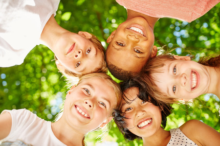 Interracial children make a team as friends in summer Stock Photo