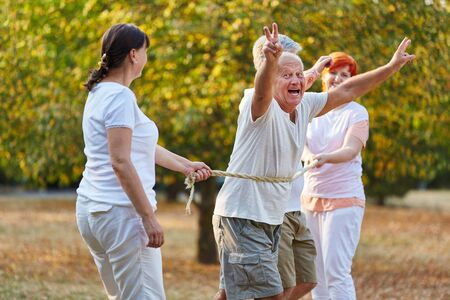 Active seniors happy of winning the race in the park