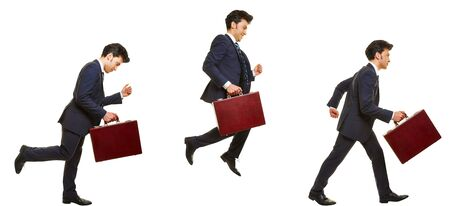 Side view of business man running and jumping with a briefase isolated on white