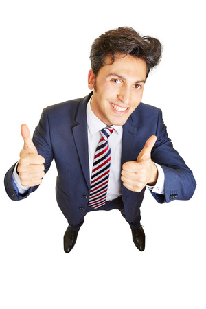 Grining business man cheering and holding both thumbs up Stock Photo