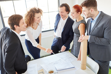 consulting room: Business people in innovation and consulting workshop as a team