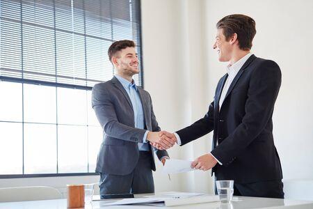 shake: Handshake between to business people as sign of partnership