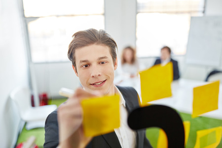 business innovation: Creative student brainstorming with sticky notes Stock Photo