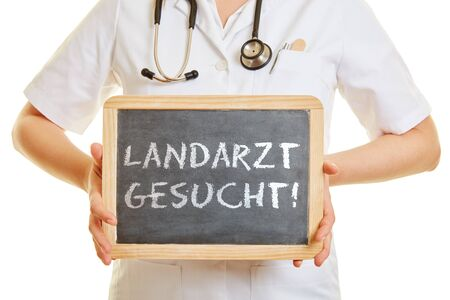 sought: Doctor holding a blackboard with the german word Landarzt gesucht! (country doctor wanted)