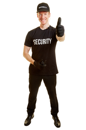 Man as a bodyguard holding thumbs up and content