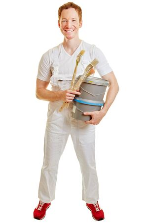 Man dressed as a painter with paint buckets and brushes on a white background Stock Photo