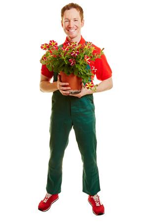 全体的に彼の手にフラワー ポットを保持している緑の花屋