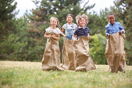 Kids having fun at sack race at the park