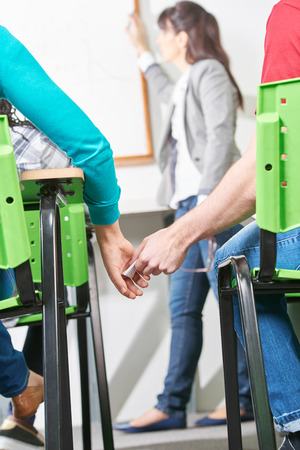 clandestine: Students in love exchange secret notes in class Stock Photo
