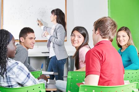 high class: Teenage students in math class in high school