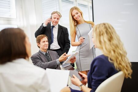 group strategy: Business team discussing a strategy in a meeting in a conference room