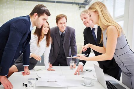 Business team with a tablet planning a strategie in the conference room