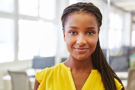 Young african woman as student trainee in business apprenticeship