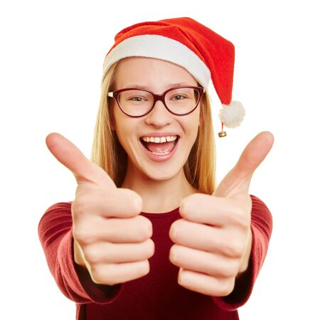 Young blond woman with glasses holds her thumbs up for christmas