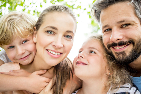 Portrait of happy family in harmony with each other in summer Фото со стока