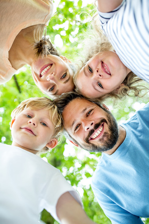 Family with children happy together play in the park Stock Photo
