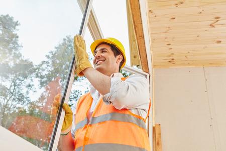 housebuilding: Window construction work in woodhouse