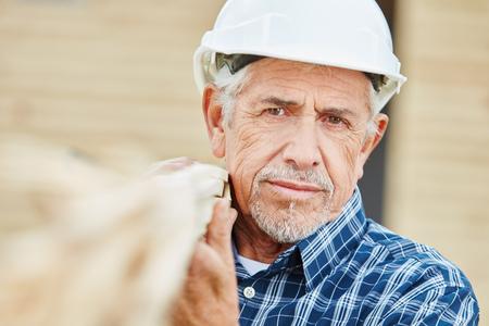 Senior as old craftsman with experience Foto de archivo