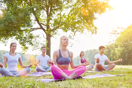tailor seat: Meditation in yoga group in summer in the nature