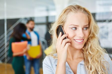 Business woman making a call in start-up