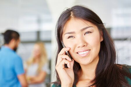 hear business call: Business woman calling hotline with phone