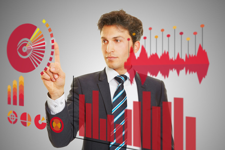 Business man checking analysis of financial data on a huge touchscreen Stock Photo