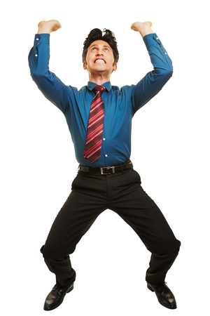 Business man lifting up an invisible object over his head