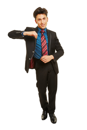 pantomima: Business man leaning with his arm on an imaginary object Foto de archivo