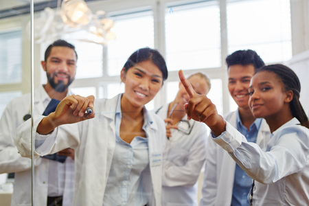 Interracial group of medical school students in study group Stock Photo