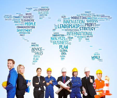 World map with business words behind group of workers and engineers together as team photo