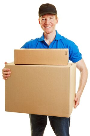 Delivery man smiling with two packages on his hands on a white background