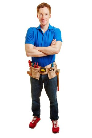 Artisan with a tool belt crossing his arms Stock Photo