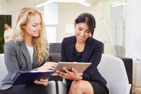 Young business women planning meeting in teamwork with tablet