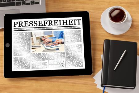 Tablet computer with the German slogan Pressefreiheit (freedom of speech) (3D Rendering) photo
