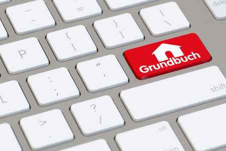 Symbol for electronic German Grundbuch (land registry) on computer keyboard (3D Rendering)