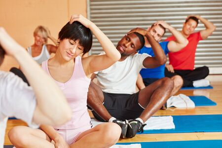 People training making pilates exercise in fitness center photo