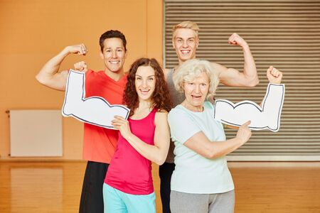 Friends and senior showing their muscles at fitness center Stock Photo