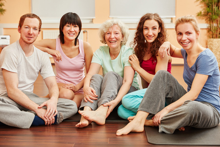 Happy friends and senior woman at fitness center photo