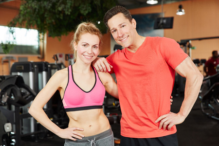 Man and woman as a trainer team at fitness studio photo