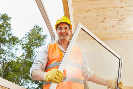 Competent window fitter working in woodhouse installation process