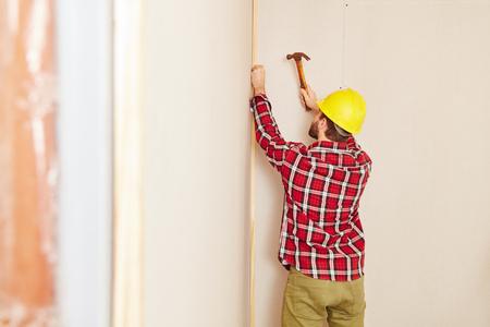 Craftsman during renovation work at woodhouse