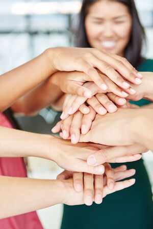 Stacked hands in start-up meeting for motivation and sign of teamwork